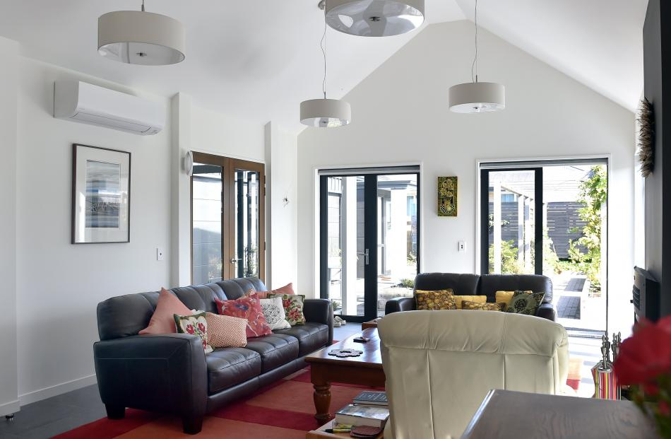 High ceilings add to the sense of space. Doors in the living area open to the atrium on one side...