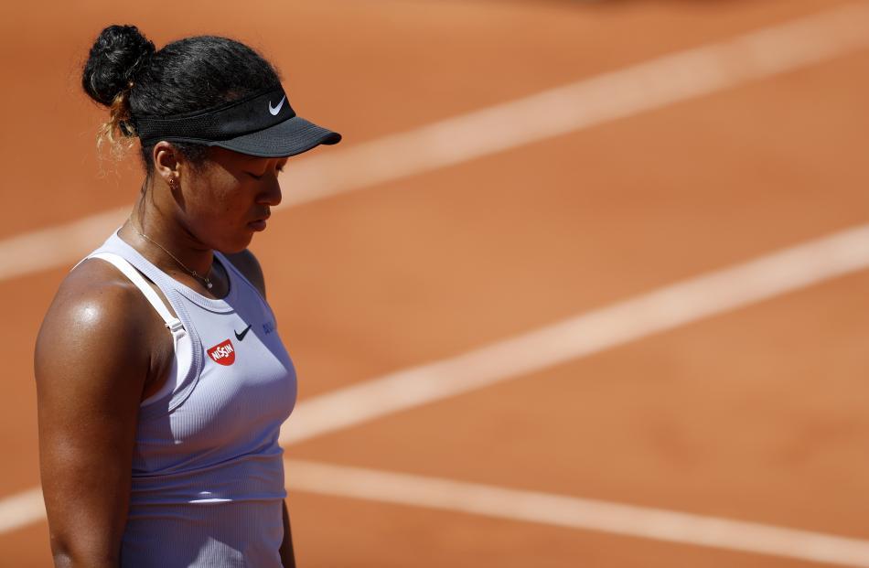 Naomi Osaka reacts during the match. Photo: Reuters