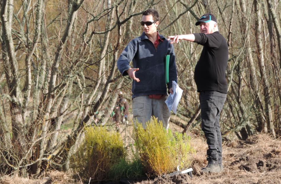 Fieldlab director Max Crowe (left), who planned the planting layout, discusses the particulars...