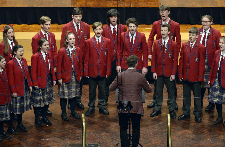 The Kavanagh College choir perform during the Big Sing at the Dunedin Town Hall yesterday. Photo:...