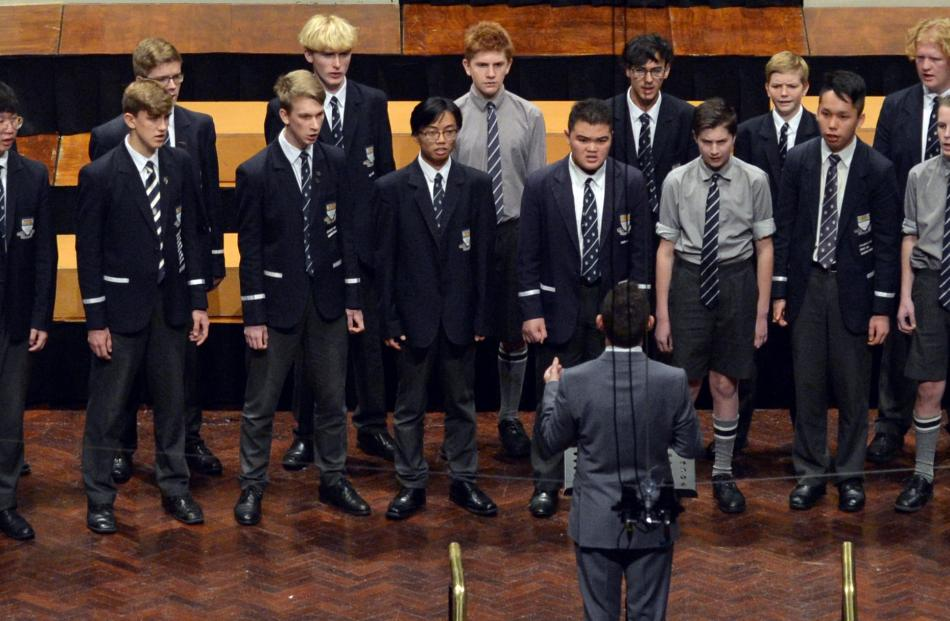 The Otago Boys' High School choir presents its piece at the Dunedin Town Hall yesterday.
