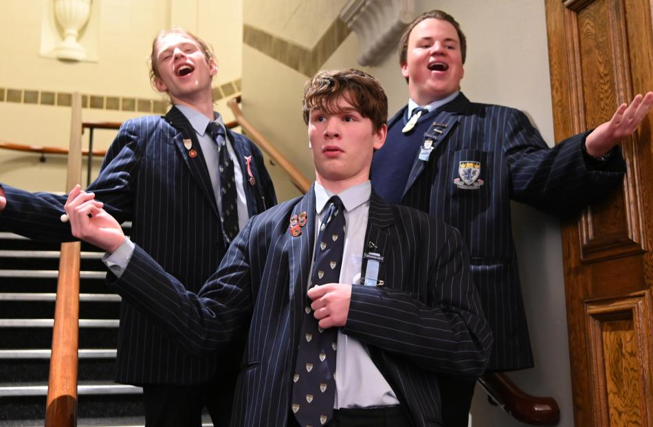 ACafellas choir members (from left) Mitchell Fox (17), Jamie Honey (16) and Tomuri Spicer (16)...