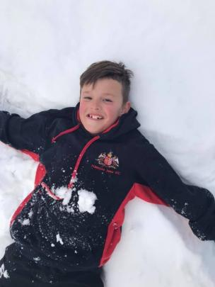 Youngsters Eddie Weir (8) and Marley Weir (7, next photo) have fun in the snow near Orangapai in...