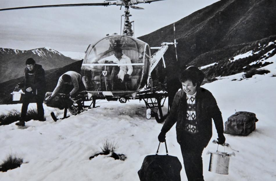 Joyce Raffills unloads gear from a helicopter at Treble Cone about 1970. Photos: Supplied by...
