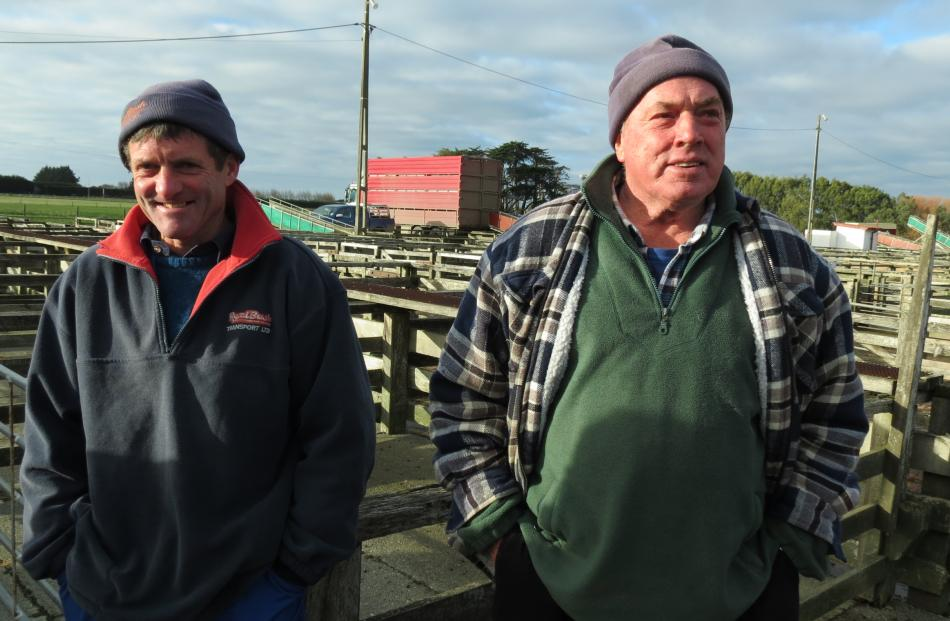 Charlie Smith, (left) of Ryal Bush Transport, chats with Eric Rowland, of Invercargill, as he...