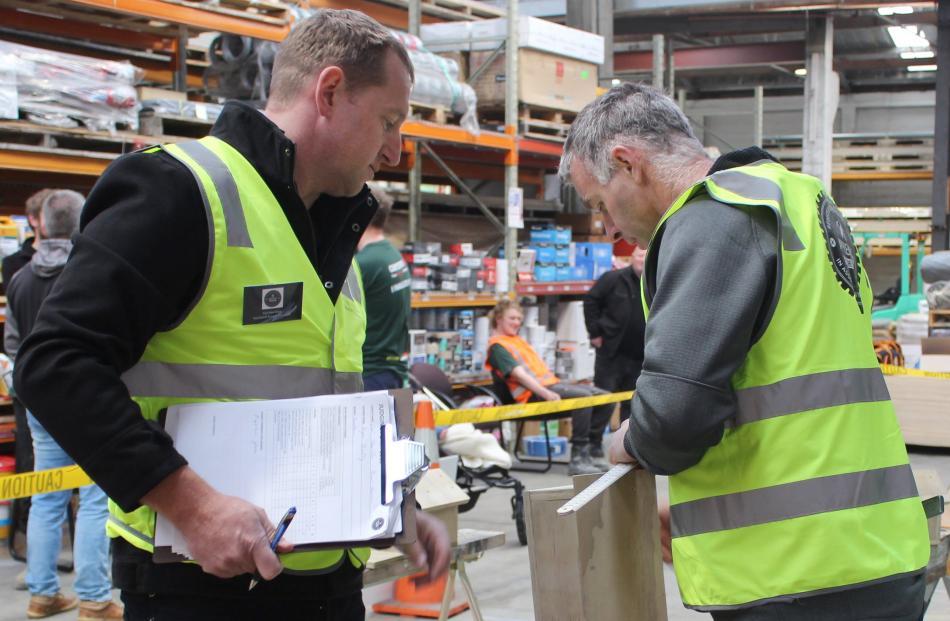 Judges Gore Master Builders president Brent Hansen and Southland Master Builders president Carl...