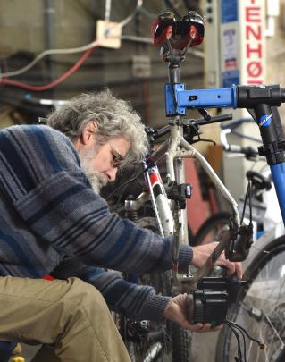 Engineer and bike specialist Steve Ward fits an electric motor to a pushbike.
