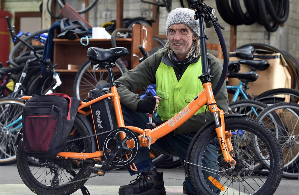 Nathan Parker prepares an electric bike for sale.