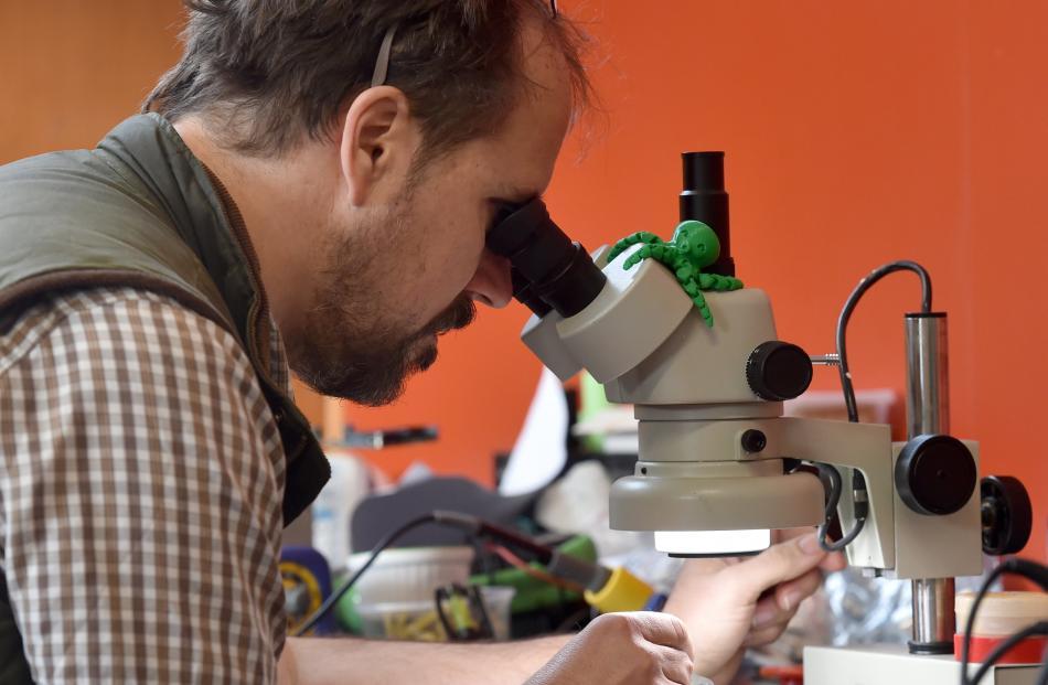 Tim Bishop works on his heat and moisture sensing electronics.