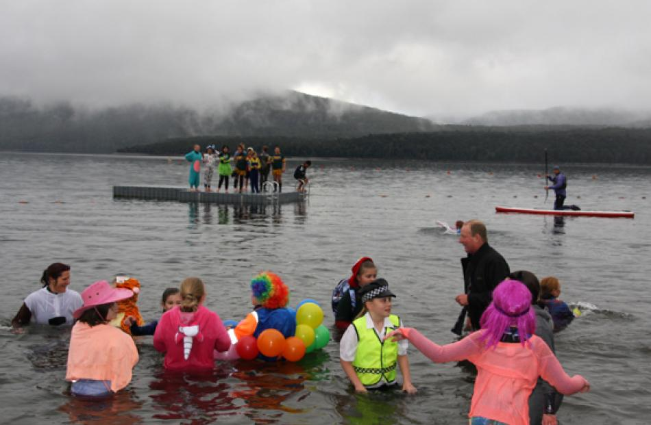 Student plungers enjoying  the lake after a chiily dip but didn't seem to deter them. According...