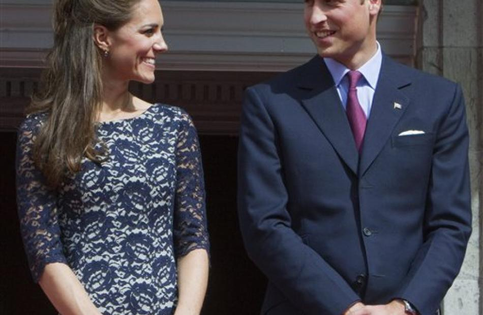 Prince William and Kate, the Duke and Duchess of Cambridge exchange a glance at Rideau Hall.
