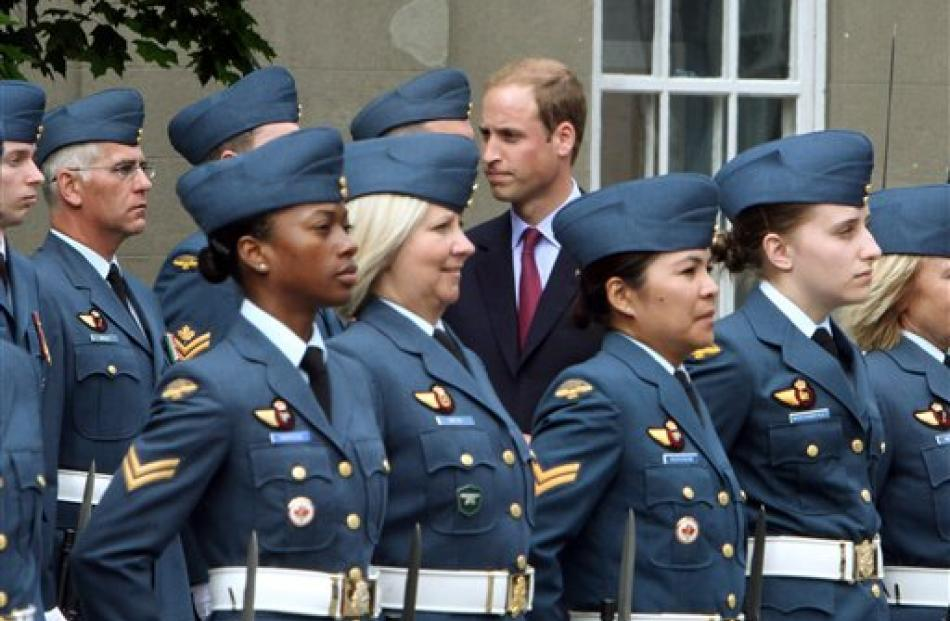 Prince William inspects a Canadian Forces guard of honour.