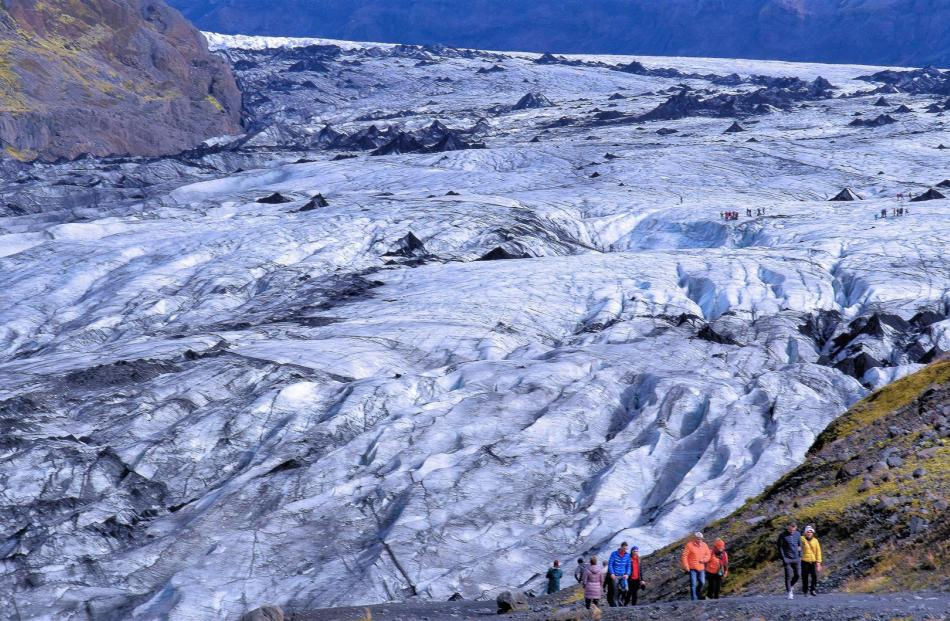 Walking to a real glacier in southern Iceland. This Myrdalsjokull glacier covers the deadly Katla...
