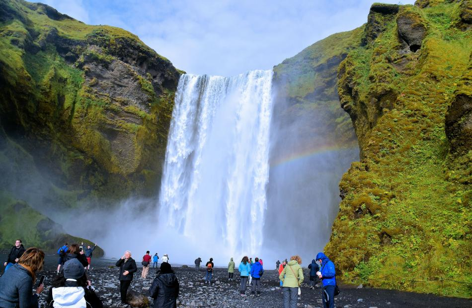 Wetting experience. Skogafoss is one of Iceland's largest waterfalls. Folklore says in Viking...