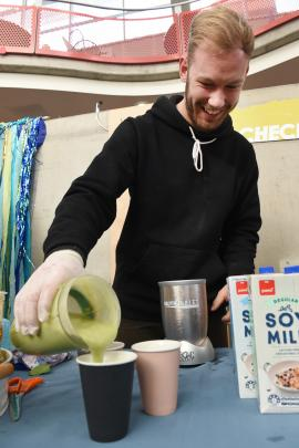 Stefan Prince (23), of Wellington, pours a healthy fruit smoothie