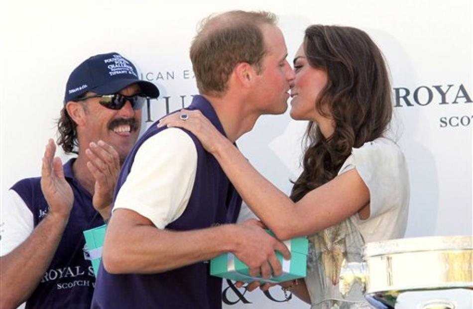 Prince William kisses his wife after his team, Royal Salute, won the Foundation Polo Challenge at...