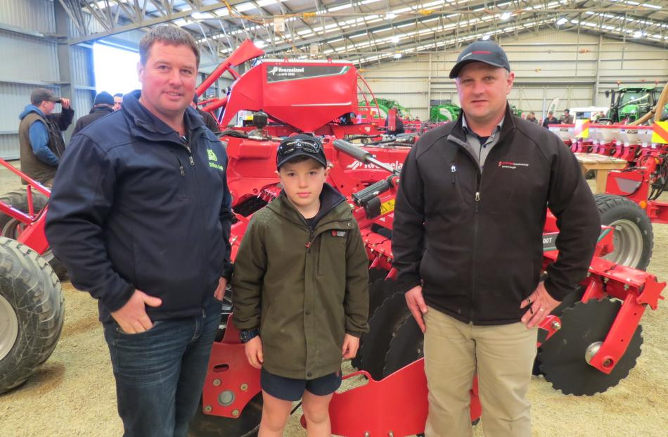 Looking at new equipment are (from left) Chris Dillon, of Dillon Ag, Balfour, his son Fergus...