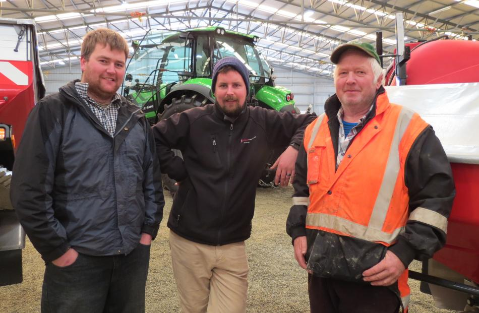 Discussing merits of machinery are (from left) Hamish Stuart, of Wrights Bush, Power Farming...