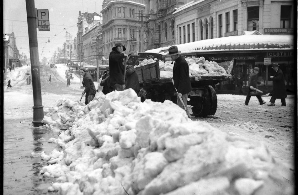 Large quantities of snow were removed from the Exchange, in Dunedin, by men with shovels and...