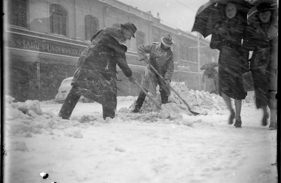 Men clear snow from footpaths and the road in George St, Dunedin. PHOTO: EVENING STAR