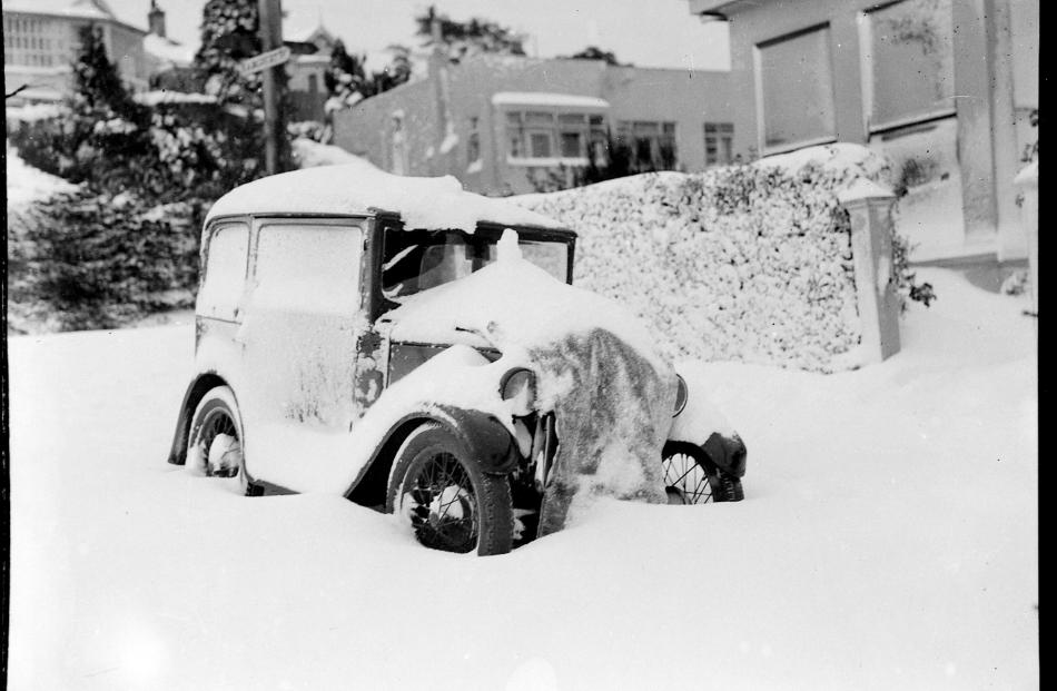 A car is buried under snow, which blocked most streets around Dunedin. PHOTO: EVENING STAR