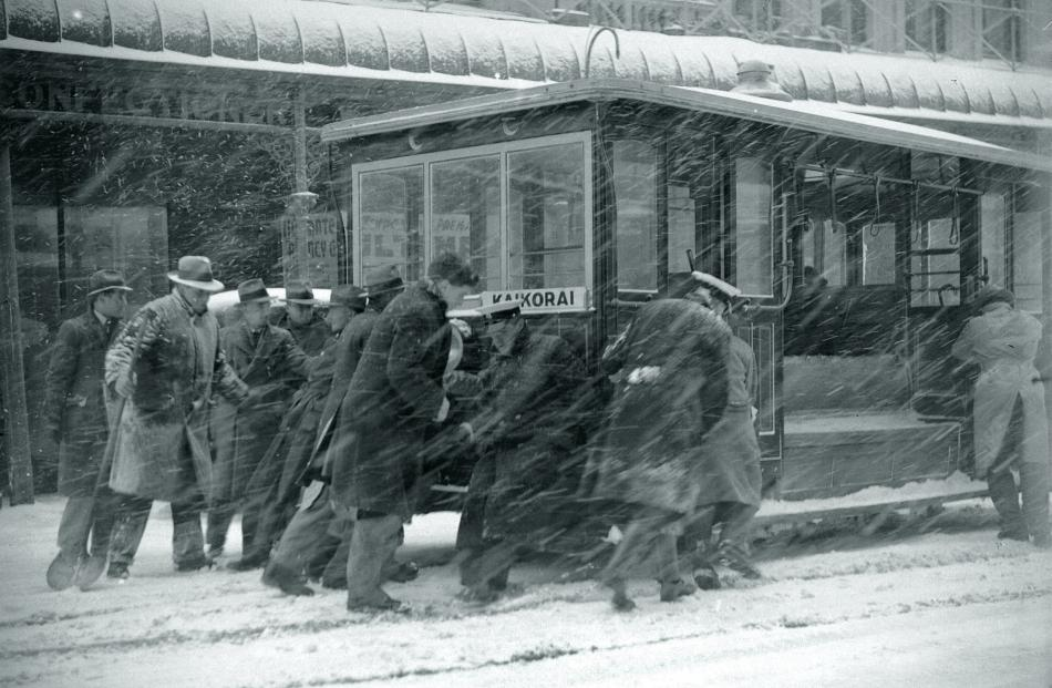 Passengers get out to push the struggling Rattray St cable car near Princes St, in Dunedin,...