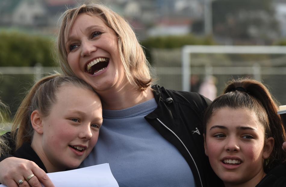 Fairfield School coach Lea Jones hugs pupils Charlie Grace-Gallagher (left) and Sarah Donaldson ...