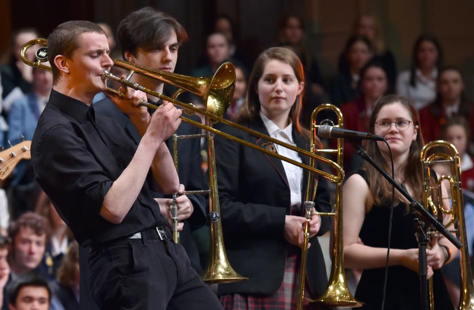 Logan Park High School pupil Finn McKinlay performs a trombone solo.