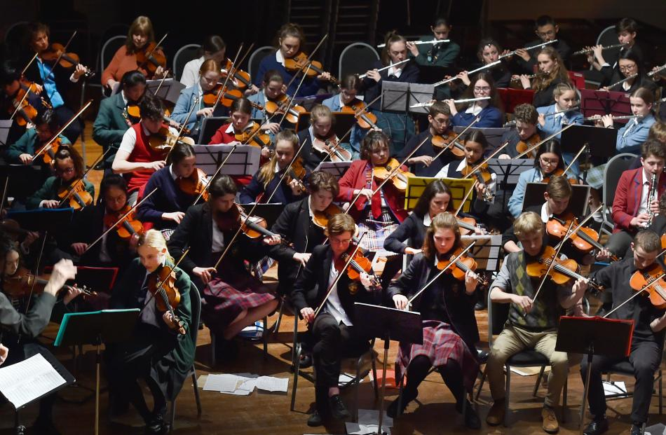 A combined schools orchestra plays Franz Schubert's Symphony No 8 Mvt 1, conducted by John Dodd.