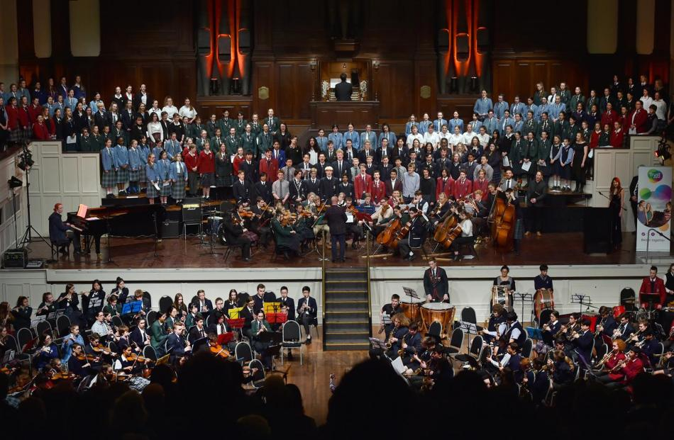 A combined schools orchestra and choir performs God Defend New Zealand at the 50th Otago Secondary Schools' Music Festival at the Dunedin Town Hall last night. Photos: Peter McIntosh