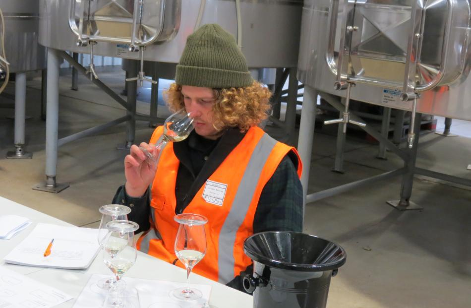 Jordan Moores, of Felton Road, tastes a wine. He came second in the competition. PHOTOS: YVONNE O...