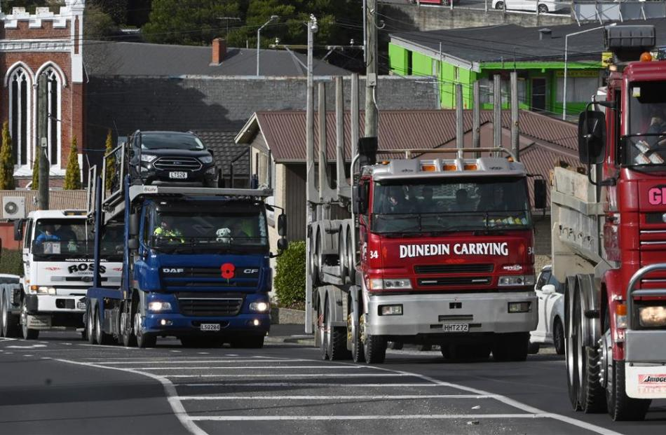 Special Rigs for Special Kids organiser Greg Inch leads a convoy  of trucks as they grind their...