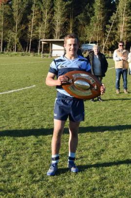 Ellesmere captain Cam Sheat with the Southbridge Shield. Photo: Karen Casey