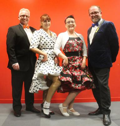 Comperes Craig Waddell (left) and Darren Ludlow, with dancers Karen Birch (second from left) and...