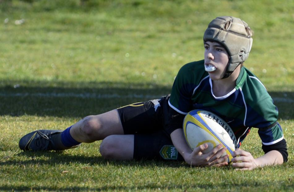 Tahuna Normal Intermediate year 8 pupil Joel Cook (13) scores a try for his side at the...