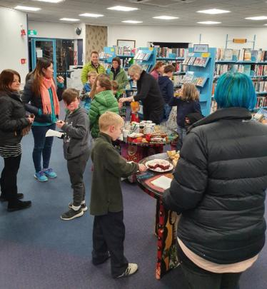Friends of the Library assisted with the event, promoting it among members and friends, as well...