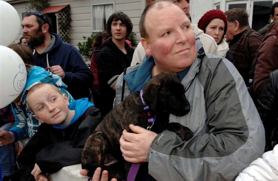 Dylan Murcott (9), his father Warren and their puppy Seeker wait patiently for the Jaffas to come...
