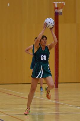 Greenpark B goal defence Mechelle Barltrop stretches. Photo: Karen Casey.
