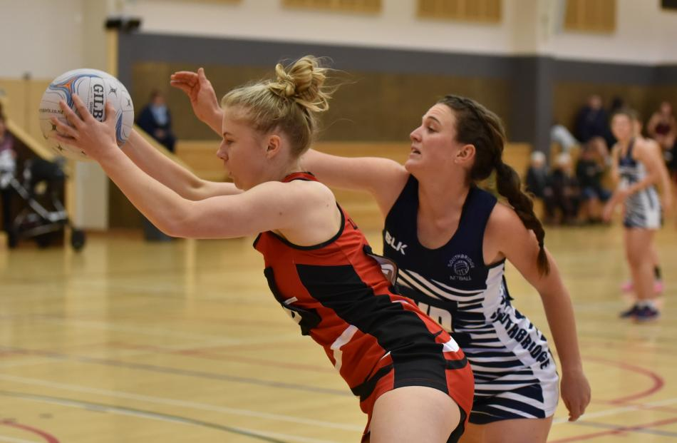 Lincoln A's Madeline Walker grabs the ball before Southbridge A's wing defence Beth Williamson during Lincoln's 71-37 Selwyn premier netball win at Lincoln Events Centre, on Saturday. Photo: Karen Casey.