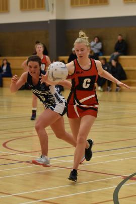 Lincoln A centre Madeleine Walker, right, beats her Southbridge oppositeBeth Williamson to the ball. Photo: Karen Casey.