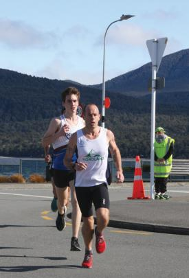 Fiordland Athletic Club Captain and Masters athlete Dwight Grieve in the lead at the lakefront...