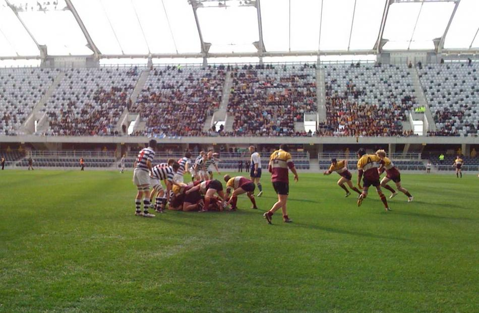 Players from the Knox and Selwyn College university rugby teams play the first game at the...