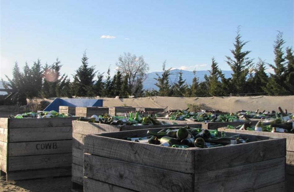 Crates of sorted glass at Central Otago WasteBusters, about to be loaded into shipping crates to...