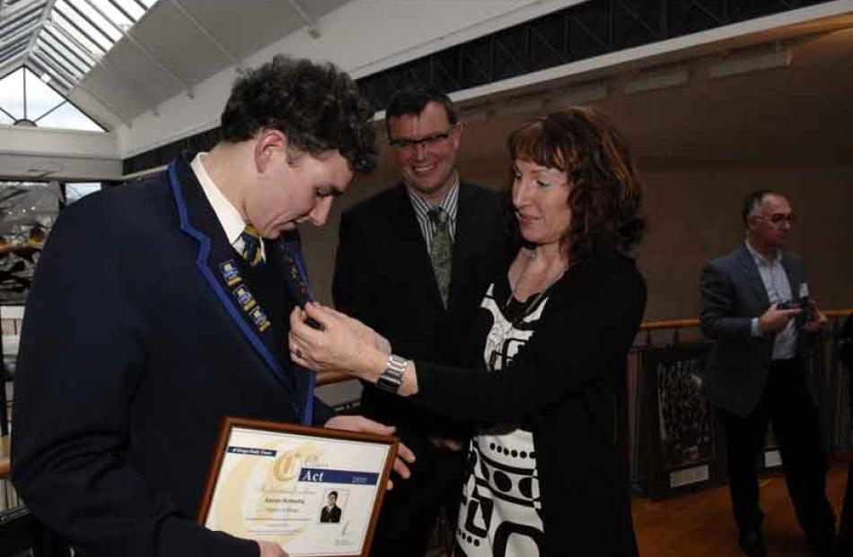 Kerri Kennedy adjusts the Class Act pin on the lapel of her son Aaron of Taieri College as her...