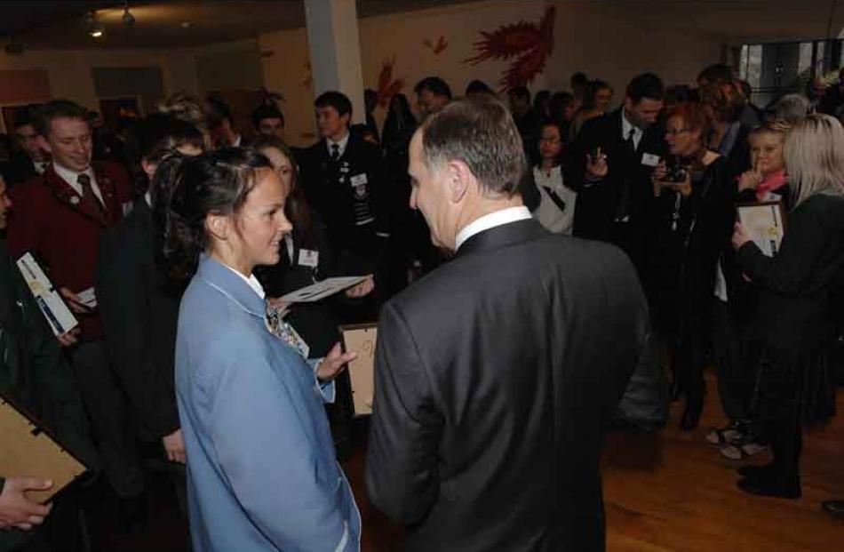 Prime Minister John Key with Rebekah Greene of St Hilda's Collegiate.