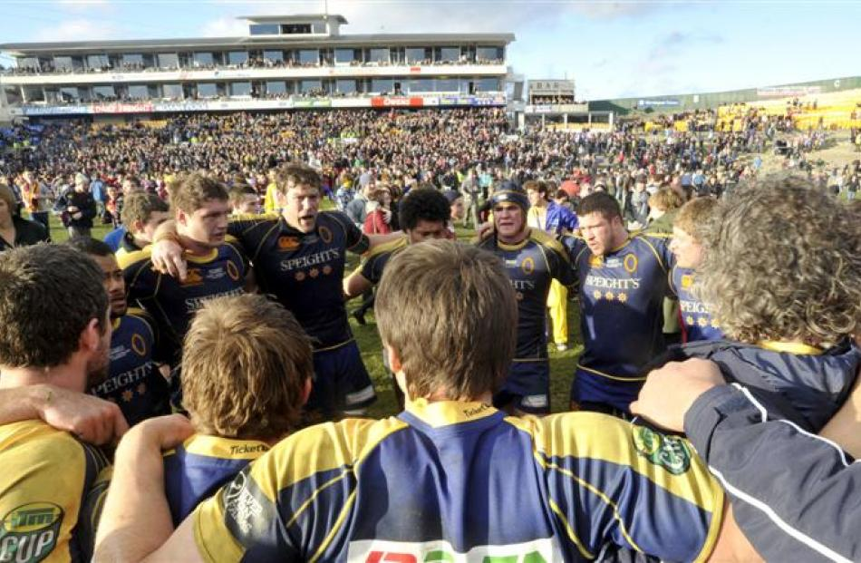 Otago players gather in a huddle after being beaten 19-12 by Southland in the last game at...