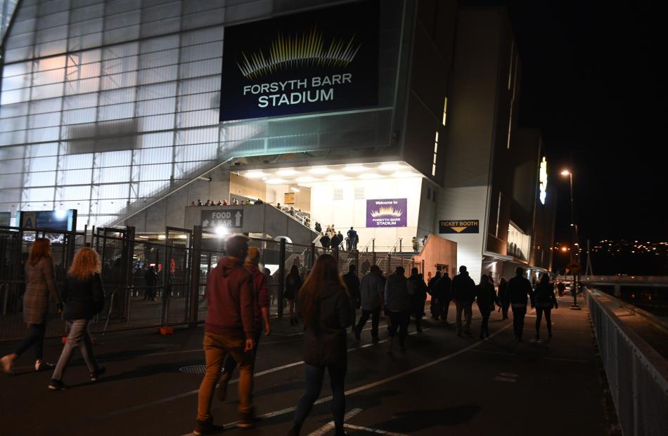Punters make their way into the stadium. Photo: Linda Robertson