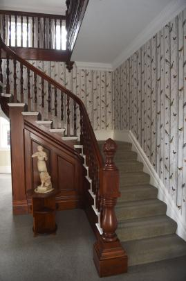 The stairwell was walled to the ceiling when the owners took possession and the newel post and...