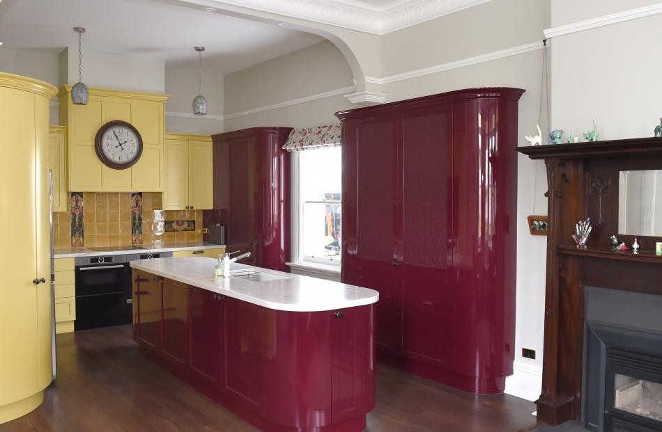 The kitchen's colour scheme was inspired by reproduction Art Nouveau tiles chosen for the...
