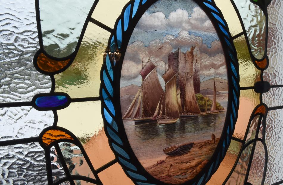 Dunedin stained-glass artist Kevin Casey took this piece of painted glass from an old damaged...
